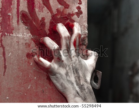 a bloody hand over background with claret