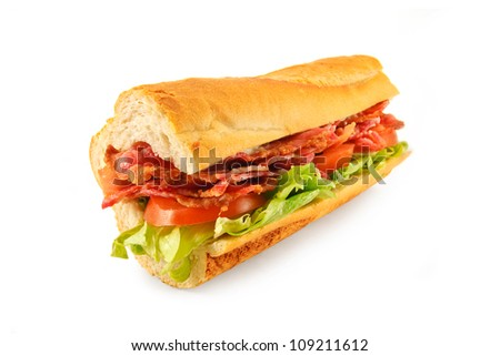 A BLT Sub roll made with Bacon, lettuce, tomato and mayo in a french bread roll