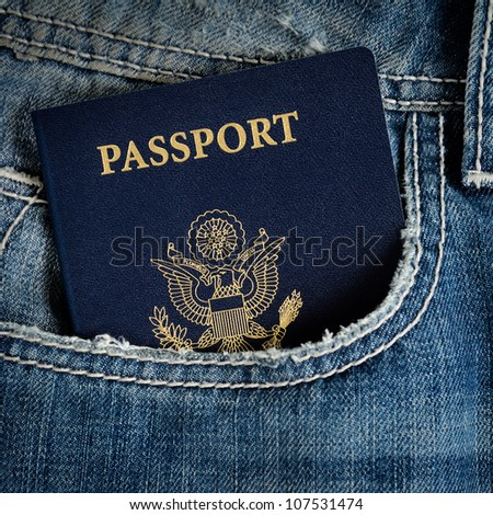 a blue american passport in pocket of jeans