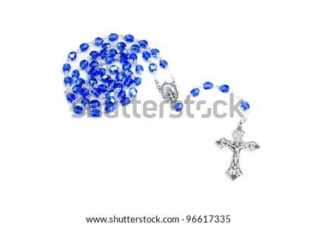 A blue and silver beaded rosary on a white background