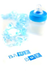 a blue baby bottle with milk and celebratory ribbon suitable for new baby