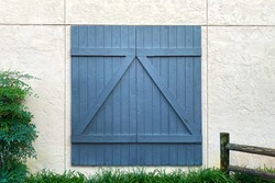 a blue barn door on a white stone building
