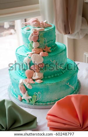 stock photo A blue beach themed wedding cake with three tiers