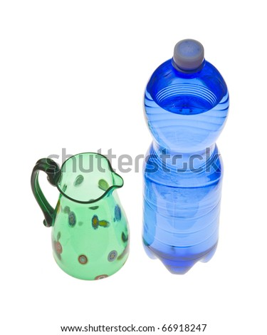 A blue bottle of mineral water and a Venetian glass jug, isolated on white.