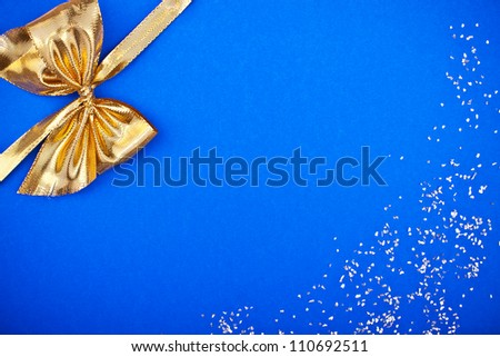a blue card with golden ribbon