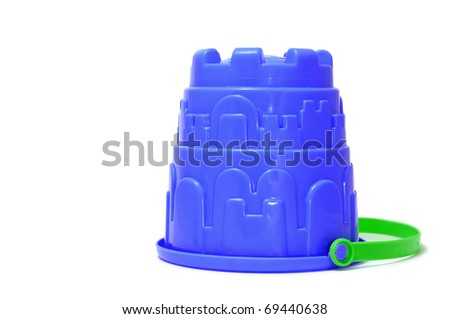 a blue castle bucket isolated on a white background