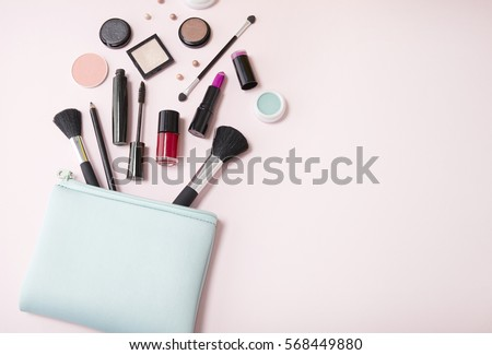 a blue cosmetics bag with...