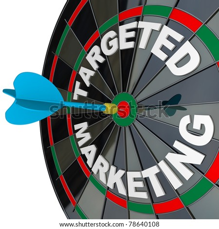 A blue dart hits a bulls-eye in the target on a dart board marked Targeted Marketing illustrating a successful advertising campaign that aims to reach a niche market