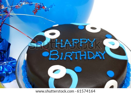 A blue decorated cake with happy birthday writing.