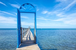 A blue door on the beach of Sandy Bay on the Roatan Island of the Caribbean Sea. Honduras