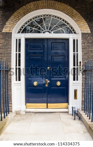 A Blue door with arched glass panels