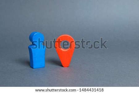 A blue figure of a man standing near a red location indicator. The man went on a Blind date. Meeting place. Venue. Online dating websites. Connecting singles