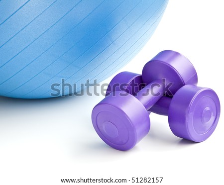 A blue fitness ball and a pair of dumbbells