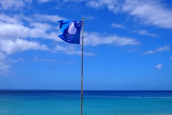 A blue flag on the beach in Morro Jable in Fuerteventura.