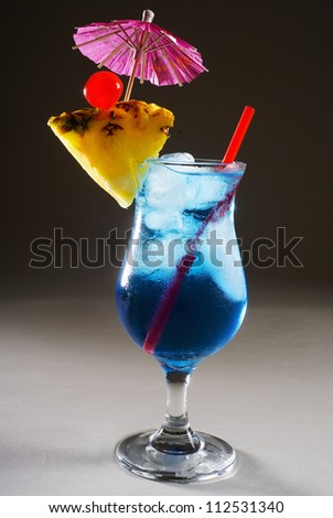 A Blue Hawaii garnished with pineapple and a cherry