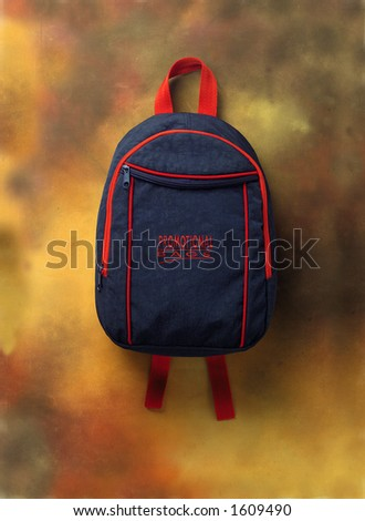 A blue knapsack over a brown background - stock photo