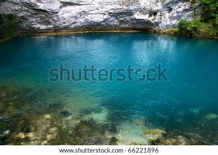a blue lake in mountains, abkhazia