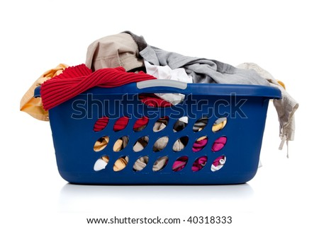 A blue laundry basket full of dirty clothes with laundry soap on a white background