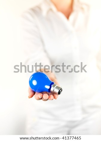 A blue light globe presented by hand isolated against a white background