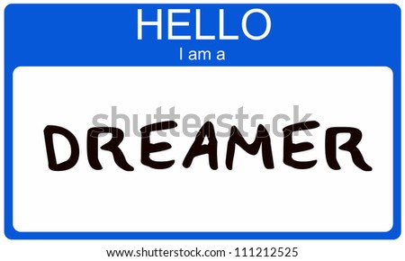 A blue nametag sticker with the words Hello I am a Dreamer written on it making a great concept image.