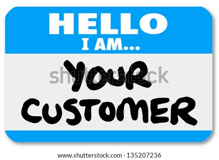 A blue nametag sticker with words Hello I Am Your Customer to represent networking, customer service or support, or contact with customers