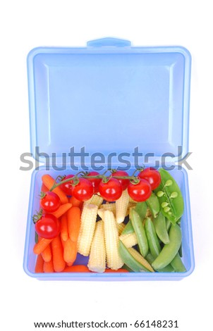 A blue open plastic school lunch box filled with healthy organic red Mediterranean vine tomatoes, chef style baby carrots, baby corn and sugar snap peas. Image isolated on white studio background.
