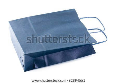 A blue paper bag isolated on white.