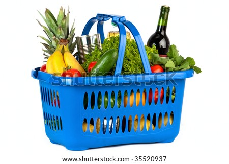 A blue plastic shopping basket on a white background filled with groceries.