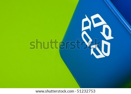 a blue recycle can on a green background
