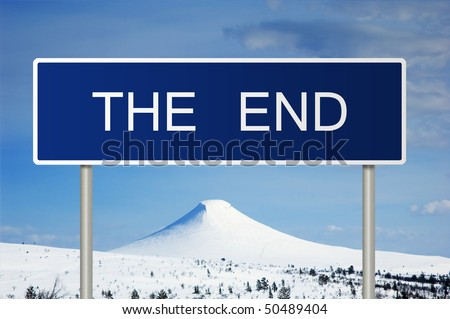 A blue road sign with white text saying The End