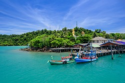A blue sky and emerald sea landscape at Ao Salat bay boat pier on Koh Kood island in Gulf of Thailand