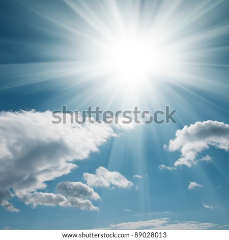 A blue sky with clouds and bright sun