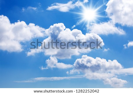 A blue sky with sun, sunbeams and clouds. #1282252042