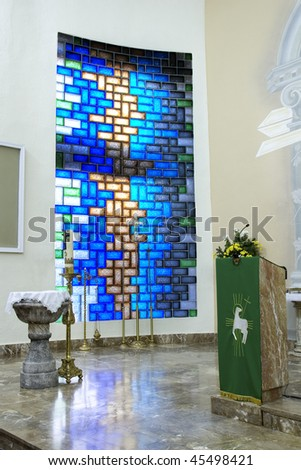 A Blue Stained Glass Window at a Church Altar