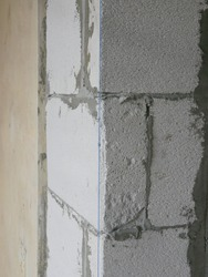 A blue string, established by the use of a plumb bob or plummet, used as a vertical reference line for wall in construction