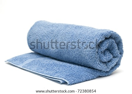 A blue towel rolled up on a white background