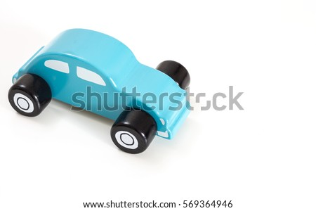 A blue toy car, on white background with copy-space. #569364946