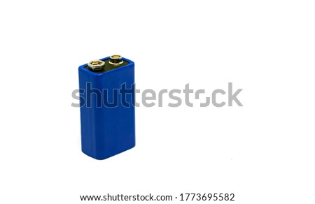 a blue 9 volt battery isolated on a white background. AC electric charge. Copy space. Environmental pollution