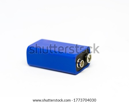 a blue 9 volt battery isolated on a white background. Power supply. Copy space. Environmental pollution