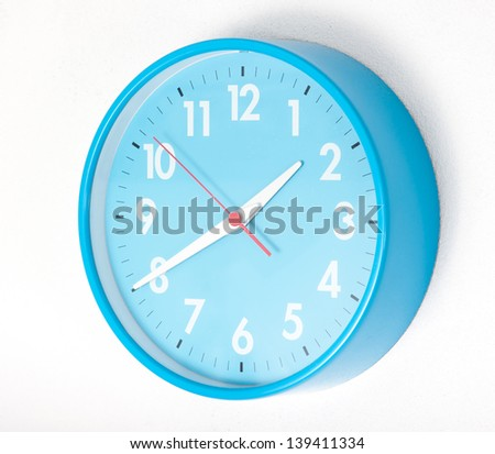 A blue wall clocks on white ground