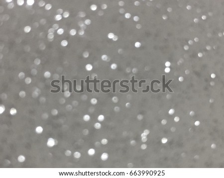 A blurred abstrack background or wallpaper or texture looks like bogeh effect or glittering effect #663990925