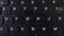 A Blurred Keybord Key on a Laptop
