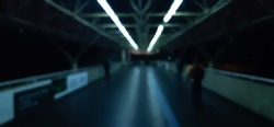 A Blurred Photo of a Bridge, Where The Silhouettes Of People Walk On. Cold Temperature, Amateur Photography