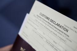 a blurred photos of customs declaration