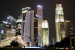 a blurry image of Singapore cityline at night