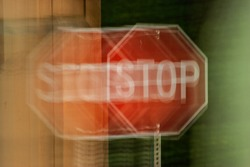 A blurry stop sign seen through impaired vision or distorted perceptions.