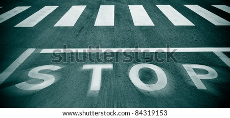 a blurry stop traffic sign in a road