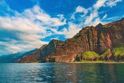 A boat cruise tour view of the coastline in Milolii State Park, located just south of Nāpali Coast State Wilderness Park on the famous Na Pali coast of the island of Kauai, Hawaii, United States.