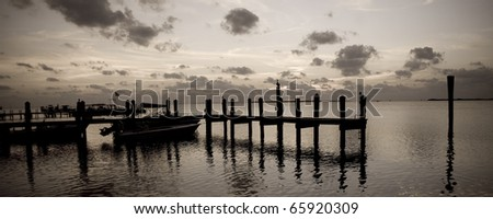 A boat dock at sunset in Key Largo Florida (sepia/panoramic).