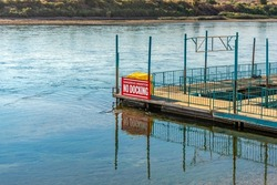 A boat dock with a No Docking sign on the Colorado River in Laughlin, Nevada